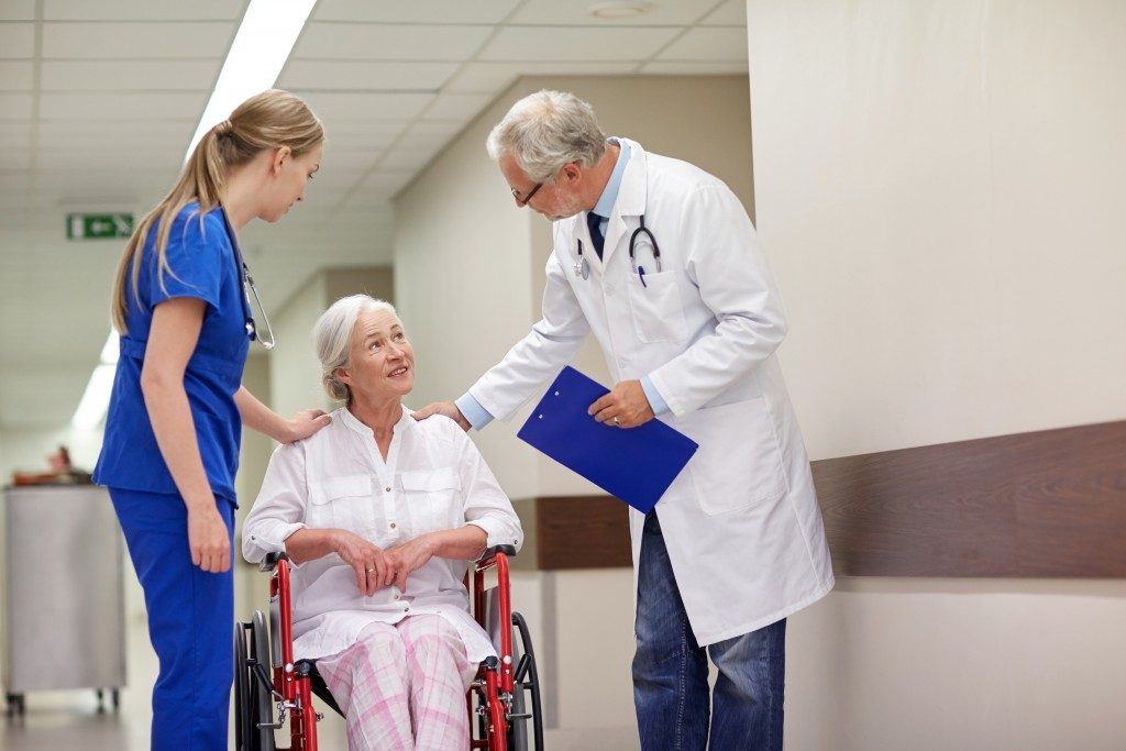 doctor and nurse attending to an elderly patient